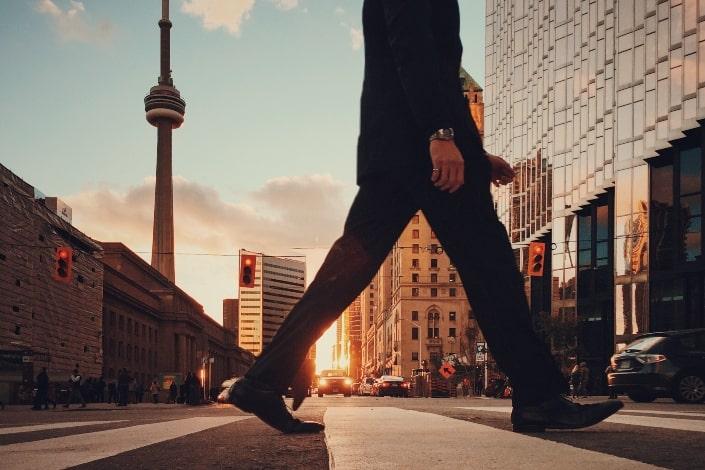 man in suit crossing the street