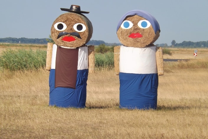 A couple created with balls of hay in Hungary