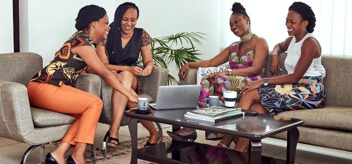 women sitting on a sofa