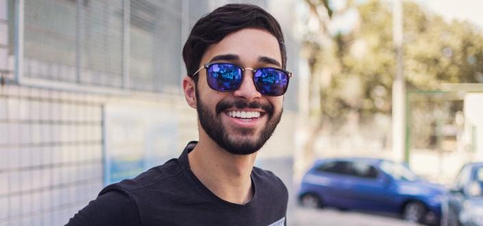 Close-up photograph of man wearing sunglasses